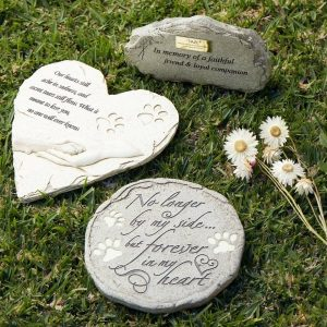 Various animal burial memorial markers in garden